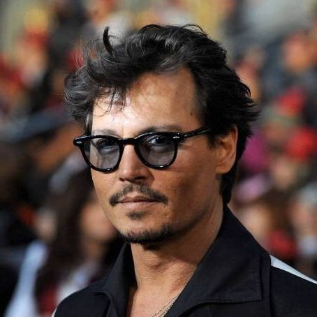 Johnny Depp in Moscot Lemtosh Black (lenti Grey)